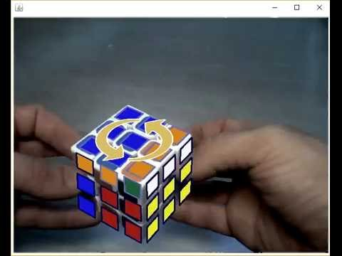 My brother made a program which recognizes Rubik's cube stickers and shows how to solve it