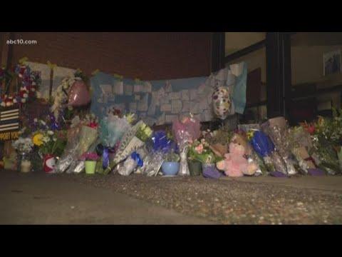 Makeshift memorial for Officer Corona set up outside Davis Police Department