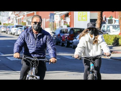 Arnold Schwarzenegger Bikes Through Santa Monica With Daughter Christina