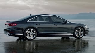 2019 Audi A8: Flagship Floats on Active SuspensionBursting with tech, including a foot massager! The auto industry's version of trickle-down economics says today's six-figure almost-limos foreshadow tomorrow's entry-level premium cars and next week's middle-class sedans and family crossovers. So it's no stretch to say that, at least for this fleeting moment, the 2019 Audi A8 sits at the vanguard of the changing auto industry with its hybrid powertrain assist as standard equipment and a laundry list of production-vehicle firsts. The fourth-generation A8 will introduce drivers to a truly active suspension, a 48-volt primary electrical system, and—in select markets—Level 3 autonomy by which Audi becomes the first automaker to sanction hands-free, Facebook-'til-your-face-melts driving. And yet all of that seems like peanuts when measured against the fact that this new A8 will happily rub even the funkiest feet after a grueling game of badminton, courtesy of a built-in rear-seat foot massager.Bring on the Gridlock!With the new A8, Audi's Traffic Jam Assist evolves into Traffic Jam Pilot. A single camera, five radar units, ultrasonic sensors, and the first laser scanner fitted to a production vehicle will allow for true hands-free driving in heavy traffic on divided highways at speeds up to 37 mph. While that makes for a fairly narrow use case outside of major metro areas, these stop-and-go commuting scenarios are also where Mark Zuckerberg whispers his sweetest seductions into a driver's subconscious.  Of note, the piloted-driving algorithm won't pester the driver with periodic reminders to grab the wheel, and the manufacturer says it will accept full liability for crashes that occur while Traffic Jam Pilot is operating. That's not to say you can crawl into the back seat for a foot massage during your two-hour slog down Interstate 5. Since the A8 will never change lanes on its own, it will require the driver to assume command to merge when a lane ends or to steer around 
