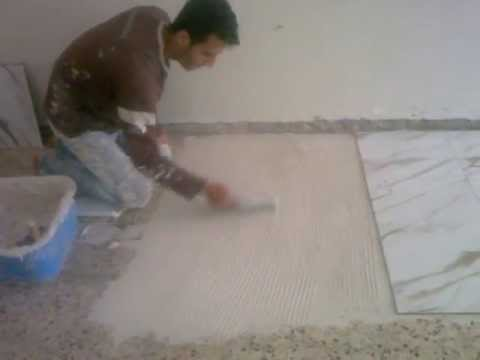 السيراميك - تركيب سيراميك بدبق سيراميك (غراء)علي سطح ناعم اداره شادي سعد الدين قطاع غزه جوال 0599862609-0597518414.
