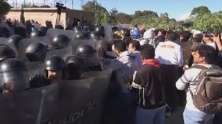 Parents clash with teachers outside school in Mexico