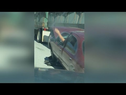 Video Car wedged under truck dragged on Calif. freeway download in MP3, 3GP, MP4, WEBM, AVI, FLV January 2017