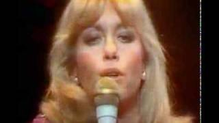 "Olivia Newton John - ""A Little More Love"" 1978(John Farrar)Night is draggin' her feetI wait alone in the heatI know, know that you'll have your wayTill you have to go homeNo's a word I can't sayCause it gets me nowhere to tell you noAnd it gets me nowhere to make you goWill a little more love make you start dependingWill a little more love bring a happy endingWill a little more love make it right?Will a little more love make it right?Where, where did my innocence go?How, how was a young girl to know?I'm trapped, trapped in the spell of your eyesIn the warmth of your armsIn the web of your liesBut it gets me nowhere to tell you noAnd it gets me nowhere to make you goWill a little more love make you start dependingWill a little more love bring a happy endingWill a little more love make it right?Will a little more love make it right?A Little More Love was lead single by English-born Australian pop singer Olivia Newton-John 1978 album Totally Hot. It was a worldwide Top 10 hit single, peaked at #4 in UK and #3 in US, during the winter of 1979."