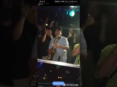 Shows up with a saxophone and takes the club by storm