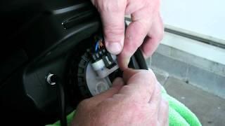 4. Removing the fuel line from a 2012 Moto Guzzi Stelvio NTX