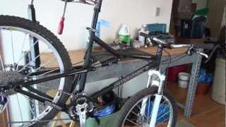 So you don't want to spend $200 on a Park tools bike stand. Using a pair of vice grips you can make your own bike repair stand. A bike repair clamp can be made by cutting a small section of pipe in half. Use a pop rivet gun to attach rubber. This will prevent the bike repair stand clamp from scratch your bike frame.