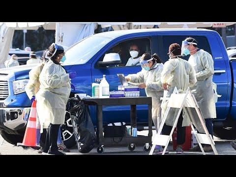 U.S. COVID-19 deaths surpass 400,000; vaccine distribution remains a challenge
