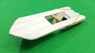 Make a DIY Wooden Paddle Boat powered by an elastic rubber band. Use lollipop sticks or popsicle sticks and a glue gun to make a paddle boat. Great fun project to make with kids.