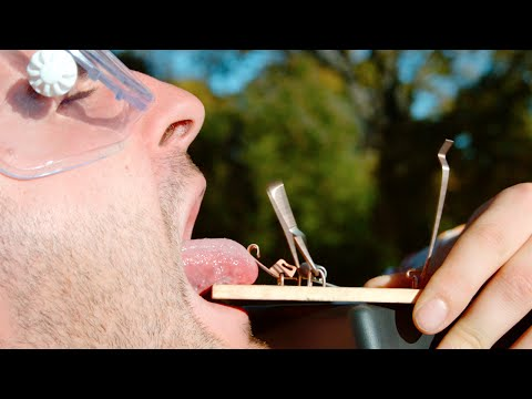 A super slow motion video of a man's tongue getting caught in a mouse trap