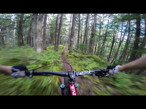 Stabilized Footage Of A Mountain Biker Flying Down A