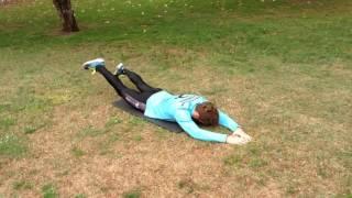 Cruce de piernas extendidas boca abajo (lumbar)