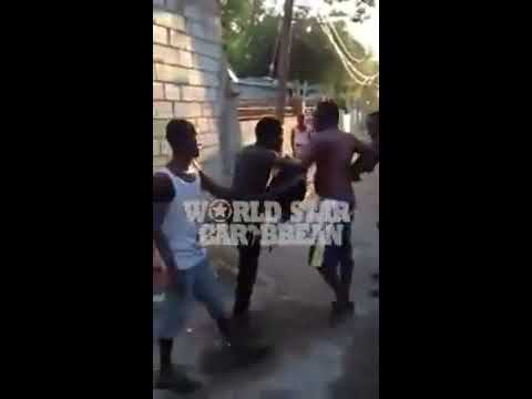 Fight In Jamaica Yute Get Jump and Some Rass Licks in His Ass