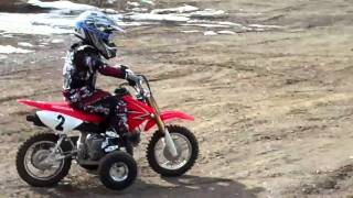 8. Logan on his 2009 CRF50F