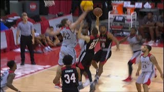 Jakob Poeltl protects the paint with a big time block to deny R.J. Hunter.