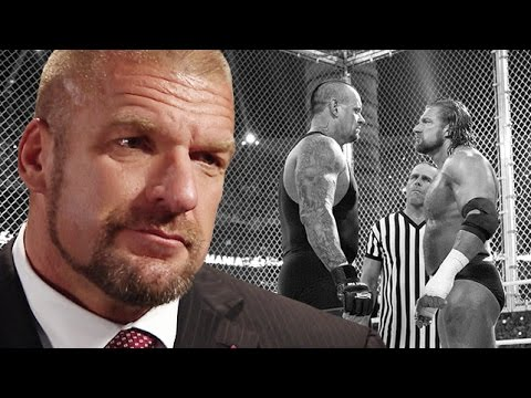 Back - In anticipation of Sunday's momentous double main event at Hell in a Cell, WWE's COO recounts his own brutal history inside the infamous structure, including his career-threatening
