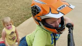 9 year old wants to ride a bigger dirt bike and can't reach the ground...