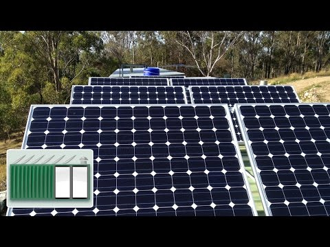 Shipping Container House – Installing large solar panel array on shipping container roof