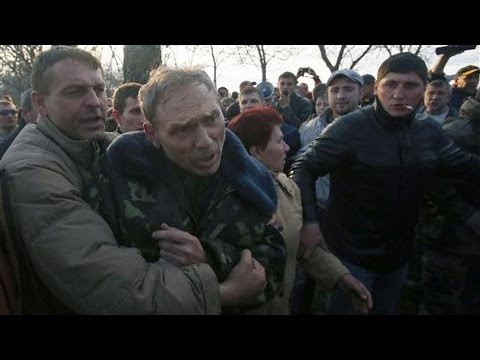 Where - Outside an airbase in Kramatorsk in Eastern Ukraine, pro-Russian demonstrators swarmed and roughed-up a Ukrainian general who came out to talk to them after ...