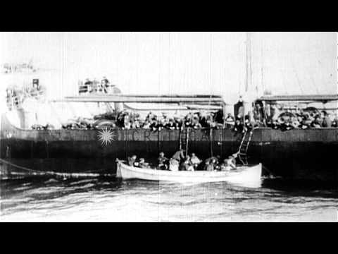 Newsreel cameramen capture ship afire in ocean, people in lifeboats, and volcano ...HD Stock Footage