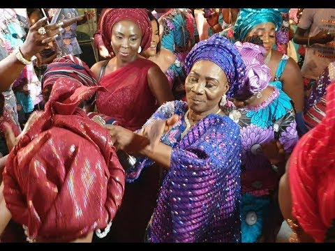 Funny! See Kunle Afod 70-Yr-Old Mum Dancing Shaku Shaku At Her Birthday As Her Kids Sprays Her