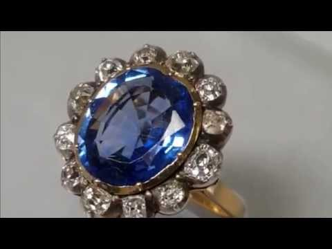 Blue Sapphire and Diamond Halo Birthstone Ring