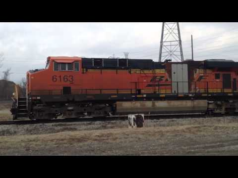 ES44AC - BNSF ES44AC 6163 startup. SD70MAC 9942 remained off while 6163 (with an apparent recent engine fire) started (what I am assuming is on a timer) in Trenton, M...