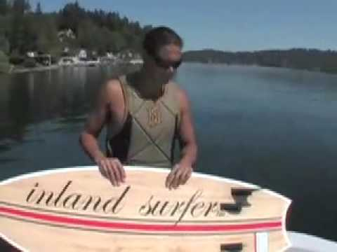 Lance riding behind a Centurion on Inland Surfer Swallow board
