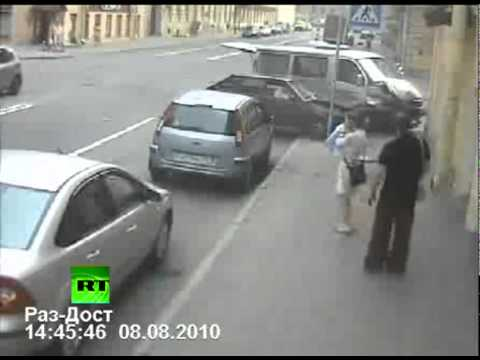 CCTV: Woman\'s narrow escape from car crash chaos