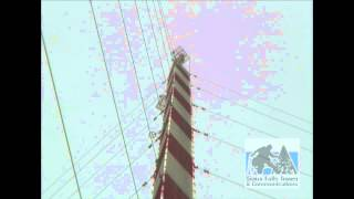This is a video showing the amount of movement a large TV broadcast tower is subjected to in a stiff wind.