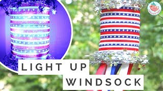 """In this July 4th crafts tutorial, learn how to make a light up windsock for July 4th or Memorial Day! This patriotic American Flag inspired windsock is a cheap and easy DIY project to decorate your home or backyard with this summer. Using a recycled bottle, ribbons, and LED lights, you can create a July 4th home decor that is beautiful to look at during the daytime or night. Perfect summer craft for last minute too!SELECT MATERIALS/ADS:Double Face Satin Ribbon: http://bit.ly/2sgjWFpAmerican Flag Ribbon: http://bit.ly/2sg6T6SStar Garland: http://bit.ly/2sg5L3fL.E.D. Lights Garland: http://bit.ly/2sg8DwQPromotional consideration provided by Paper Mart. All opinions are my own. Shop Paper Mart: https://fbit.co/5JmJMUSIC: Wallpaper  """"Wallpaper"""" Kevin MacLeod (incompetech.com) Licensed under Creative Commons- By Attribution 3.0 License http-//creativecommons.org/licenses/by/3.0/.mp3------ABOUT: Hello my crafty friends! I'm Jenny, from NYC, and I LOVE to craft. I've created hundreds of paper craft and origami tutorials, do-it-yourself (DIY) crafting tutorials, and general craft tutorials, so be sure to subscribe and check back frequently. :-)INSTAGRAM: https://Instagram.com/OrigamiTree/FACEBOOK: https://www.Facebook.com/OrigamiTreeSNAPCHAT: https://www.snapchat.com/add/OrigamiTreeTWITTER: https://Twitter.com/OrigamiTreePINTEREST: http://www.Pinterest.com/OrigamiTreeWEBSITE: http://www.OrigamiTree.comShare your crafts in the Fan Gallery (bit.ly/OTFanGallery), or on social media with #OrigamiTree. You may also visit OrigamiTree.com, for free craft tutorials, demos, printable origami paper, and more!Business Inquiries: JennyOrigamiTree@gmail.com"""