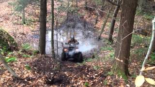 9. Arctic Cat 700 EFI trying to crawl out of mud hole and up hill (Part 1)