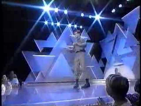 "Performer ""3-D"" earns the $25k grand prize with an omnious lip-sync performance of Paul Hardcastle's ""19"" on national TV, 1985."