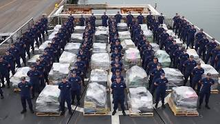 The crew of Coast Guard cutter Waesche, homeported in Alameda, California, offloads approximately 18 tons of cocaine at 10th ...