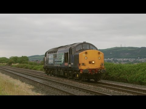 DRS 37601 'Class 37 Fifty' passing Prestatyn light engine...