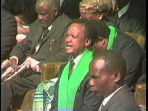 Chiluba praying during funeral of the Zambia National team in 1993