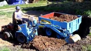 Мини трактор МТЗ-132. Экскаваторная установка. Mini tractor MTZ-132. Excavator installation.