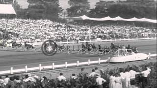 Goshen (NY) United States  City pictures : A large crowd gathers to watch harness racing Hambletonian in Goshen, New York. HD Stock Footage