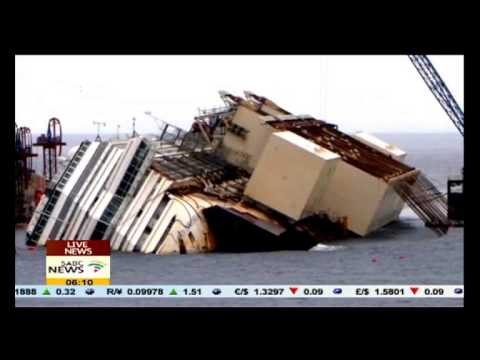 cruise ship Italy - Salvage workers were poised to begin hoisting upright the wrecked Costa Concordia cruise ship on the Italian island of Giglio on Monday in the biggest ever s...