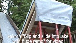 Slip and slide into lake with huge ramp