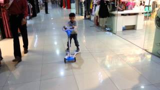 Barka Oman  city pictures gallery : Rudra happy with his new scooter at Golden Dragon Mart, Barka, Oman.