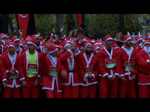 Thousands Dressed as Santa Claus Run for Charity