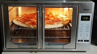 FIRST LOOK Oster XL French Door Convection Oven I did 400 for 15 min remember you have to hit the start but 2x