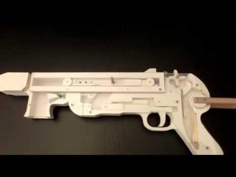Видео как сделать из бумаги автомат который стреляет резинками