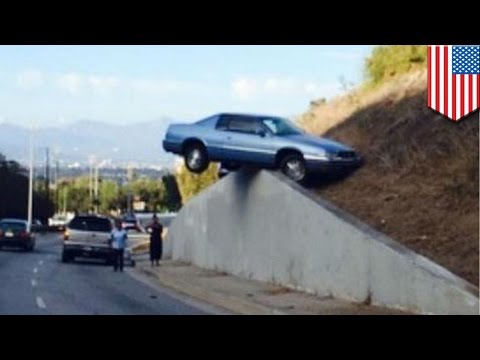 los - A car lost control and spilled off the road and landed on a wall in Los Angeles Sunday. According to an NBC news report, the vehicle skidded up the concrete retaining wall after losing control...