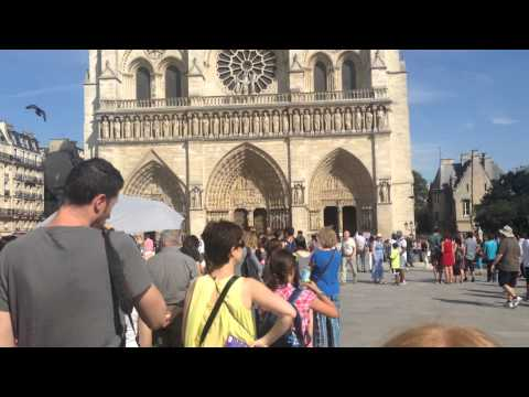 Cathedral Notre Dame of Paris and Touriststourists