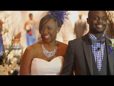 Two beautiful people jump the broom in this African American wedding