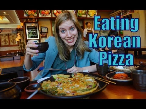 Eating Korean Pancakes along with Korean wine in Yongin, Korea video
