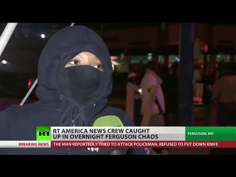RT - For the eighth night, police and residents of Ferguson, MO clashed on Monday over the shooting of Michael Brown. The National Guard joined local law enforcement on the streets, firing tear...