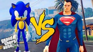 """Sonic vs Superman no GTA 5 Gameplay em Português, no PC, jogando com GTA 5 Mods. Todos os vídeos de GTA 5 Mods ► http://bit.ly/1qkLltlMais um vídeo de GTA 5 e hoje continuamos nossas Batalhas até a Morte! Sonic chegou chegando e vai desafiar Superman, um dos caras mais fortes em nossas batalhas até a morte! Será que ele obtém êxito? Hoje a gente teve participação extra de Goku e de Rick e Morty! Twitter ► http://bit.ly/1qr6HERInstagram ► http://bit.ly/1mr1YrrFacebook ► http://bit.ly/29sdpzISEGUNDO CANAL ► http://bit.ly/CriadoresdeConteudoContato: hsogameplays@gmail.com=====================Baixe o app do canal e veja tudo em um só lugar - https://goo.gl/cKuOxq NOVA ERA GAMES ► http://www.novaeragames.com.br (Utilize o Cupom desconto """"Hagazo"""" (sem as aspas) para 5% de desconto em toda a loja==================Music by Epidemic Sound (http://www.epidemicsound.com)---------------MOD do Superman - ttp://gtaxscripting.blogspot.com.br/2016/10/wip-superman-script.htmlMOD do Sonic - www.youtube.com/quechus13"""